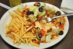 Alimento deixado em uma placa Fotografia de Stock Royalty Free