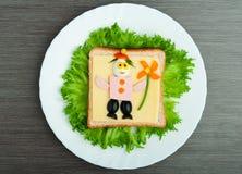 Alimento del diseño. Emparedado creativo para el niño Imágenes de archivo libres de regalías