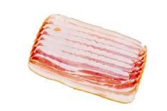 Alimento del tocino de la carne aislado sobre el fondo blanco Foto de archivo libre de regalías