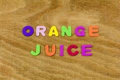 Alimento della bevanda di colore del succo d'arancia imparare le lettere dei bambini fotografia stock libera da diritti