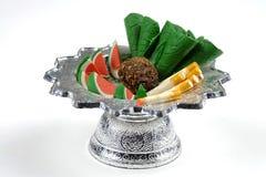 Alimento della scultura in vassoio per il sacrificio Fotografia Stock