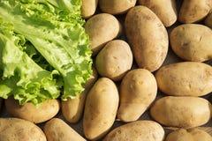 Alimento delle verdure crude delle patate nel mercato per struttura ed il fondo del modello Fotografia Stock