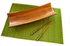Alimento di legno del bambù della stuoia delle bacchette Fotografie Stock