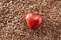 Alimento do coração da semente de linho da linhaça Fotos de Stock Royalty Free