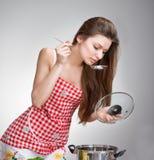 Alimento do gosto da mulher Imagens de Stock Royalty Free