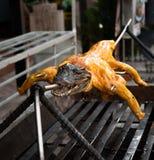 Alimento esotico - coccodrillo sulla griglia Fotografia Stock
