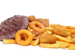 Alimento espanhol da engorda: hamburgueres, croquetes, calamares e frenc Imagem de Stock