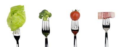 Alimento fresco do vegetal cru e da carne em forquilhas Fotos de Stock Royalty Free