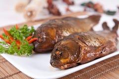 Alimento na porcelana--peixes fritados Foto de Stock Royalty Free