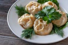 Alimento natural Mantas da abóbora do vegetariano em uma placa branca, decorat imagens de stock royalty free