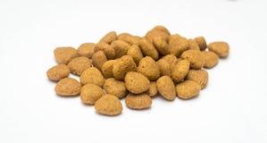 Alimento para cães em um fundo branco Foto de Stock Royalty Free