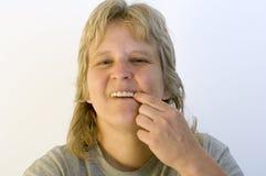 Alimento pegado en dientes Foto de archivo libre de regalías