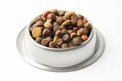Alimento per animali domestici in ciotola d'argento Immagini Stock Libere da Diritti