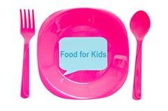Alimento per l'etichetta dei bambini sul piatto vuoto e cucchiaio isolato sulle sedere bianche Immagine Stock
