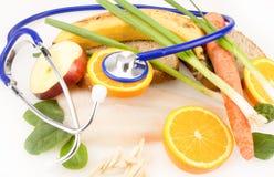 Alimento sano con lo stetoscopio Immagine Stock Libera da Diritti