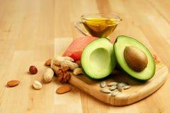 Alimento sano Ingredientes por completo de la grasa sana en la tabla fotografía de archivo libre de regalías