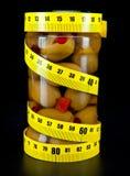 Alimento sano verde oliva y de medición de la cinta Fotos de archivo