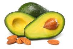 Alimento saudável abacate cortado com as amêndoas isoladas no fundo branco Fotografia de Stock Royalty Free