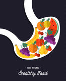 Alimento saudável: estômago humano que come frutos naturais ilustração royalty free