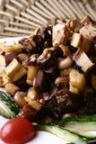 Alimento squisito della Cina--porco ed arachide e radice Immagini Stock