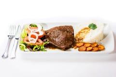 Alimento típico do venezuelano do negro de Asado Imagem de Stock