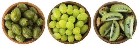 Alimento verde su un fondo bianco Bacche e frutti isolati su bianco Fotografie Stock