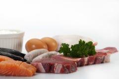 Alimentos abundantes en proteínas en cierre para arriba Imágenes de archivo libres de regalías