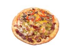 Alimentos naturales de la forma. Pizza de los alimentos de preparación rápida. Fotos de archivo