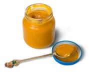 Alimentos para niños en tarro en blanco Imagenes de archivo