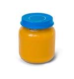 Alimentos para niños en tarro en blanco Fotos de archivo libres de regalías