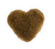 Aliments pour chiens en forme de coeur photos stock