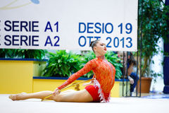 Alina Maksymenko with hoop. DESIO, ITALY - OCTOBER 19: Alina Maksymenko from Ukraine performs with hoop during the rhythmic gymnastic italian championship on royalty free stock photo