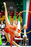 Alina Maksymenko with hoop. DESIO, ITALY - OCTOBER 19: Alina Maksymenko from Ukraine performs with hoop during the rhythmic gymnastic italian championship on royalty free stock images