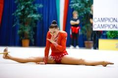 Alina Maksymenko with hoop. DESIO, ITALY - OCTOBER 19: Alina Maksymenko from Ukraine performs with hoop during the rhythmic gymnastic italian championship on stock photos