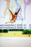 Alina Maksymenko with hoop. DESIO, ITALY - OCTOBER 19: Alina Maksymenko from Ukraine performs with hoop during the rhythmic gymnastic italian championship on stock image