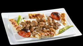 Alinazik kebab. Is made from smoked and spiced eggplant, grilled and then pureed, topped with cubes of sauteed lamb, previously seasoned and marinated Royalty Free Stock Images
