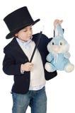 Alineada adorable del niño del ilusionista con el sombrero Fotografía de archivo