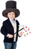Alineada adorable del niño del ilusionista con el sombrero Imagen de archivo