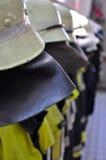Alineada de los bomberos Imágenes de archivo libres de regalías