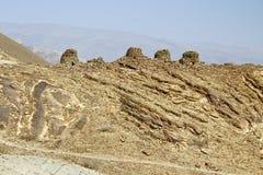 Alineado dramáticamente encima de un canto rocoso, las tumbas de la colmena de B Fotos de archivo