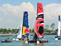 Alinghi racing Red Bull Sailing Team at Extreme Sailing Series Singapore 2013 Stock Photos