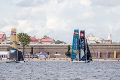 Alinghi (SUI) and Oman Air (OMA) catamarans on Extreme Sailing Series Act 5 catamarans race. SAINT-PETERSBURG, RUSSIA - SEPTEMBER 2, 2016: Alinghi (SUI) and Oman Royalty Free Stock Photography