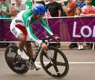 Alireza Haghi  in the Olympic Time Trial. Iranian Cyclist Alireza Haghi  on the road in Surrey during the London 2012 Olympic Cycling Time Trial Stock Image