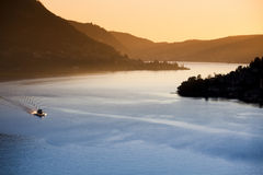 Aliscafo sul lago. Lake of Como to the sunset and point of Laglio Royalty Free Stock Photo