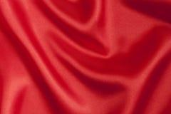 Alise el fondo rojo del satén Foto de archivo
