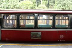 ALISHAN TRAIN STATION, TAIWAN - APRIL 12, 2015. Public Train leaves from Alishan Station in Alishan National Scenic Area, Taiwan on April 12, 2015. This is a Royalty Free Stock Image
