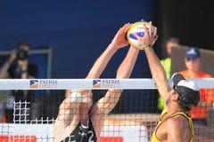 Alison und Sean Rosenthal - setzen Sie Volleyball 2012 auf den Strand Stockfotografie