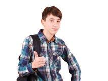 Aliste para estudiar Mochila que lleva del adolescente hermoso en un hombro y sonrisa aislada en blanco Imagen de archivo