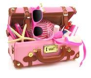 Aliste para viajar maleta rosada Imagenes de archivo