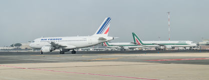 Alitalia and Air France on the runway Stock Images